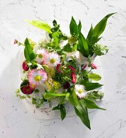 Daisies and various wild herbs in small vases