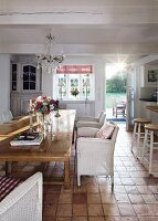 Open-plan kitchen with rustic dining area