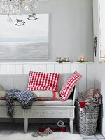 A bench with red and white checked cushions in a Scandinavian-style room