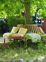 Wooden tree bench with scatter cushions