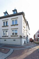 An old town house with a basement in a pedestrian area