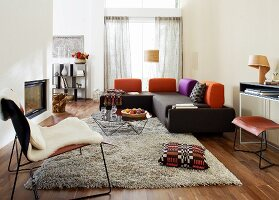 Modern furnishings in living room with corner sofa & long-pile rug