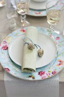 A place setting decorated with a rolled napkin and quail's eggs