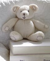A white knitted teddy bear