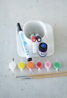 Utensils for painting porcelain: crockery, paint, fine liners and brushes