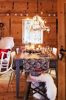 A dining table laid for Christmas dinner in a rustic room