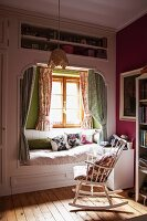 Girl's bedroom with cubby bed & rocking chair