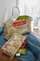 A wash bag and a make-up bag made from fabric printed with a map of London