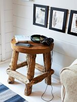 Hand-crafted, wooden stool used as side table
