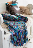 A coloourful scarf with a woven pattern