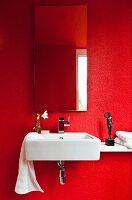 Sink in guest toilet painted vivid red