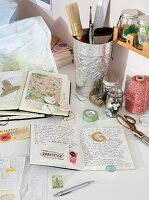 Open book and other stationery on table