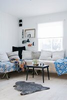 Comfortable, vintage-style corner sofa with scatter cushions and blankets