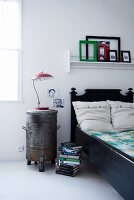 Industrial style in bedroom: old bin used as bedside table