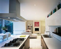 View from open-plan, fitted kitchen counter of seating and dining areas