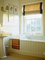 Victorian bathroom with sash window and blind