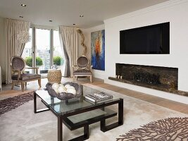 Art Deco coffee table in front of open fireplace