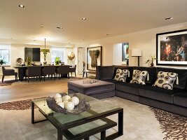 Art Deco-style coffee table in front of modern sofa in open-plan room