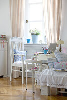 Small home office in romantic country-house-style room with delicate, white vintage furniture
