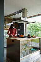 Teenager preparing food on kitchen island in open-plan kitchen