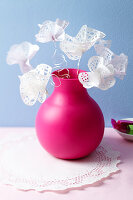 Doily flowers in a rubber vase