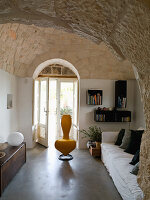 Renovated interior with vaulted stone ceiling in a Trullo house