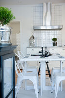 Retro-style kitchen table and metal chairs in country-house kitchen