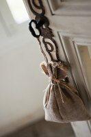 Lavender bag hanging from key in door lock