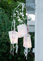 Mobile made of paper-bag lanterns as garden decoration