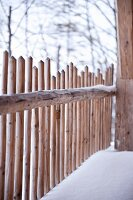 Wooden fence in winter atmosphere