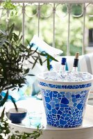 Ceramic pot painted with mosaic tile pattern as home-made ice bucket