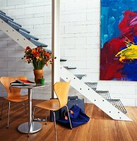 Side table and Bauhaus chairs in front of staircase