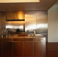 Designer kitchen with free-standing, stainless steel island