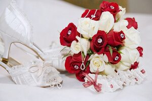 Bridal bouquet, garter, jewellery and shoes