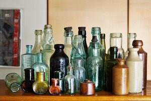 Collection of vintage bottles on wooden surface