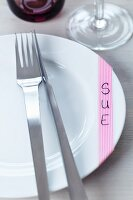 An alternative to place cards: patterned masking tape on the dinner plate, with the name written on
