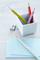 Pencils decorated with colourful patterned tape in white china pot