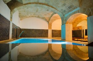 Indoor pool below vaulted ceiling