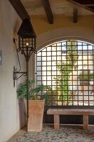 Wrought iron lantern on veranda wall of a Mediterranean house