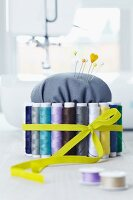DIY pin cushion with spools of thread and elastic band