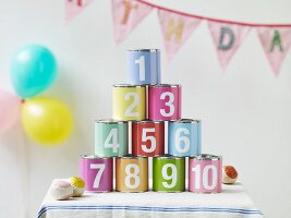 Child's birthday party: balloons, bunting and pyramid of tin cans