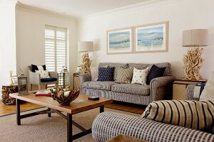 Sofa set, coffee table and artistic accessories made from root wood in living room