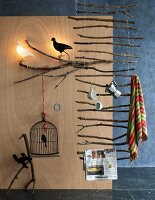 Ladder-like suspended rack made of branches & various ornaments with bird motifs