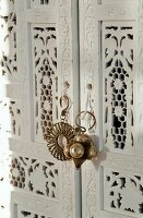 White-painted, Oriental wardrobe (detail)