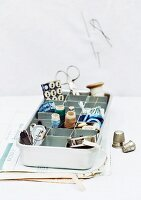Ice cube try used for organised storage of sewing utensils