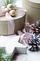 Decorated Christmas gift box, pinecones and star-shaped ornament