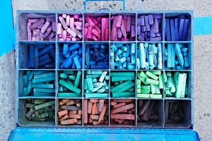 Colorful chalk in a metal box
