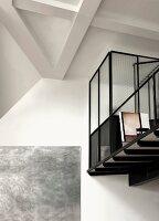 Mezzanine with glazed installation and modern artwork on wall