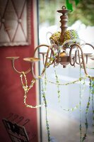 Chandelier with strings of glass beads in craft shop