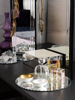 Perfume and jewellery box on dressing table in bedroom